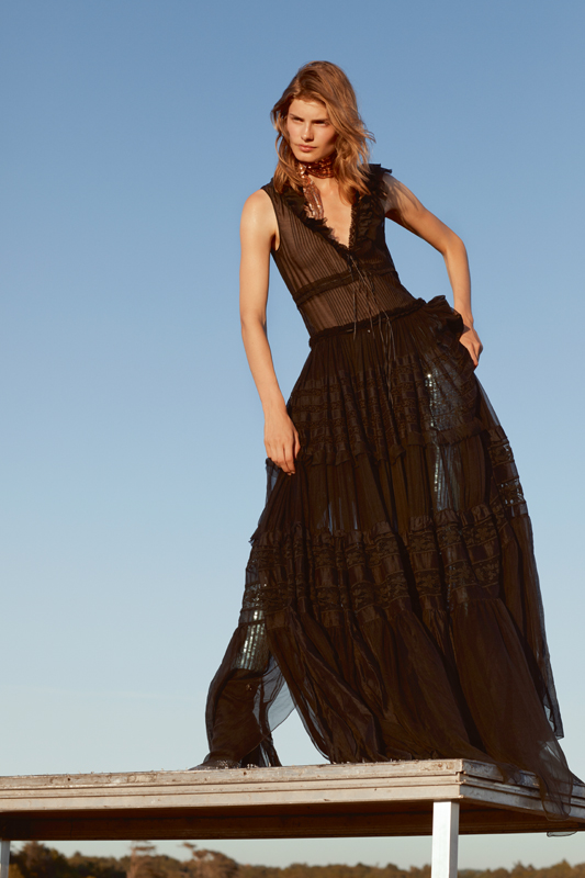 Pleated cotton long dress and sequined leggings, DSQUARED2. Ankle boots, GIUSEPPE ZANOTTI.