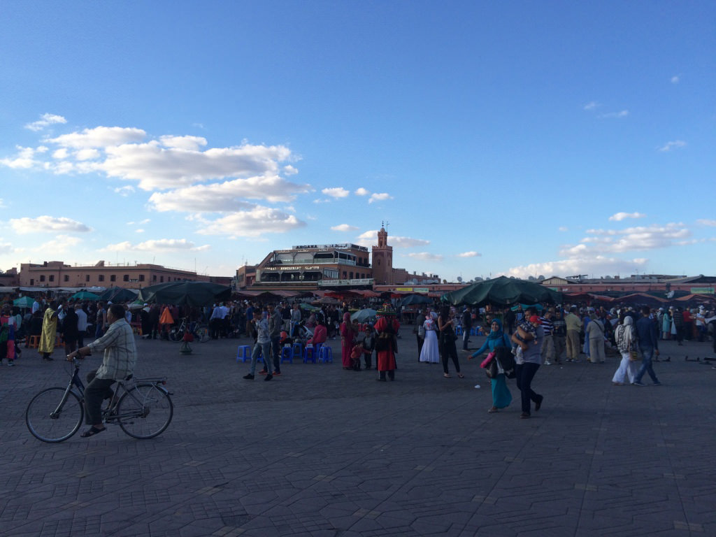 The Jemaa-el-Fna square just before dusk.        RECREATING THE COLLECTIVE, EXCHANGING, THE ART OF SHARING    Tino Sehgal's 'halqa' appears as an organic body in constant mutation, fully integrated within its environment. A veiled woman comes face to face with the artist to exchange a mystical gesture, teenagers experiment with hip-hop battles, masters of other halqas on the square pass by to bless that of Tino Sehgal… The artist offers a journey through time, like one we rarely see. A fusion of traditional Moroccan tradition with western modernity, classical choreography and street dance, an elder dressed in traditional garb and young girls in skirts. The artist has succeeded in recreating an ephemeral collective, just for a day, a night a month. A veritable communion of senses, emotions and sensations...      Place Jemaa el-Fna, Marrakech, from May 13th to June 5th, 11.00 to nightfall (except Mondays)   Tino Sehgal is represented by the Galerie Marian Goodman.   By Thibaut Wychowanok