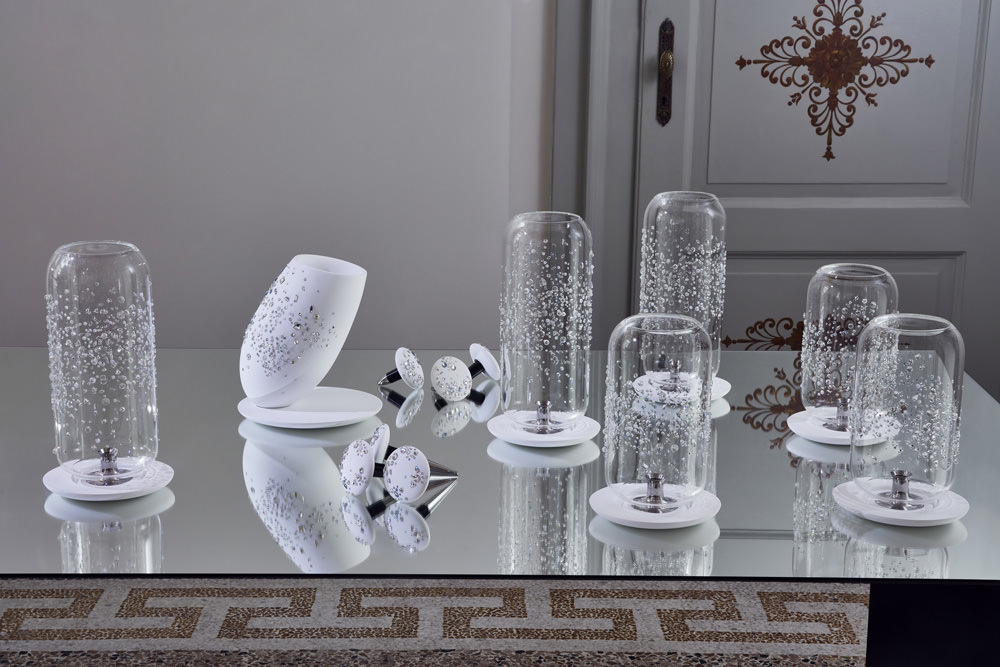 Orbite de luxeby Tord Boontje. Recreational objects, lanterns, ice buckets, dry fruits bowl and a glass, Corian, and cristal caviar service.