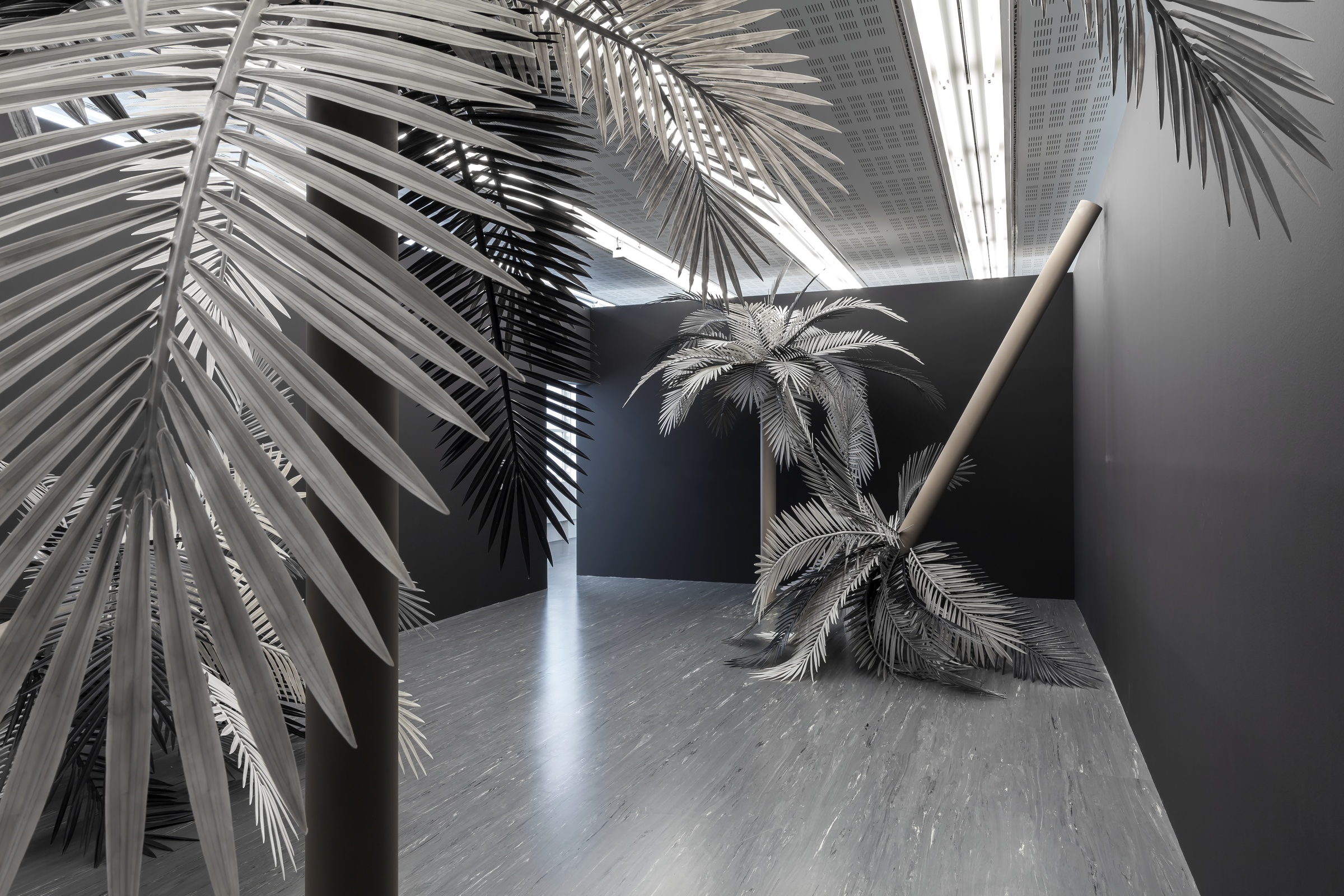 Sarah Ortmeyer, Baden-Baden (Koko I–IV) [2016]. Courtesy of Sarah Ortmeyer and Dvir Gallery, photo : Belvedere       4. IN THE TROPICS OF SARAH ORTMEYER   Sarah Ortmeyer sent me this photo of her exhibition at the Kunsthalle in Baden-Baden (on until August 28th). She developed a project at the Monnaie de Paris [French national mint] where she installed a hundred or so eggs beneath palm trees instead of coconuts… Sarah went to the Städelschule fine arts academy in Frankfurt and now resides in Vienna. Her exhibitions and her installations are always incredibly elegant, both ultra-minimalist and very funny. She might be a conceptual artist but she remains equally fascinated by pop culture. I remember her book about Riri, Fifi and Loulou, whose names were translated into every language, and her obsession with Shiloh Jolie-Pitt, the tomboy daughter of Brangelina. Sarah also worked on Kant and the way the philosopher would dress according to the environment in which he found himself. That resulted in Kant Elegant, a series of sculptures featuring big brand clothes draped carefully over plants.      www.kunsthalle-baden-baden.de