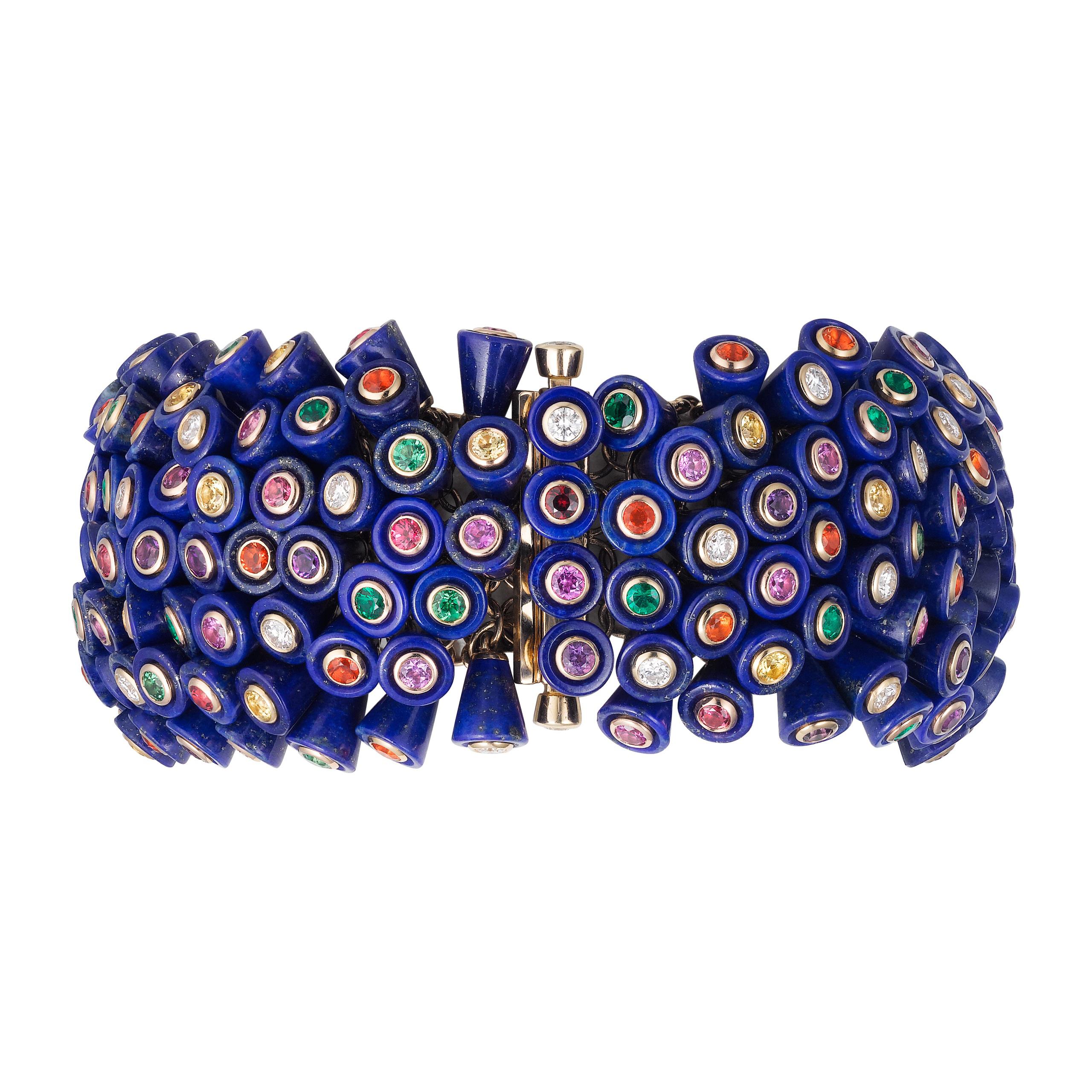 """Bracelet """"Paris Nouvelle Vague"""" en or jaune serti de 252 lapis-lazuli, de 31 spinelles, de 30 saphirs roses, de 31 saphirs jaunes, de 29 grenats tsavorites, de 31 améthystes, de 26 émeraudes, de 30 opales de feu et de 46 diamants, CARTIER."""