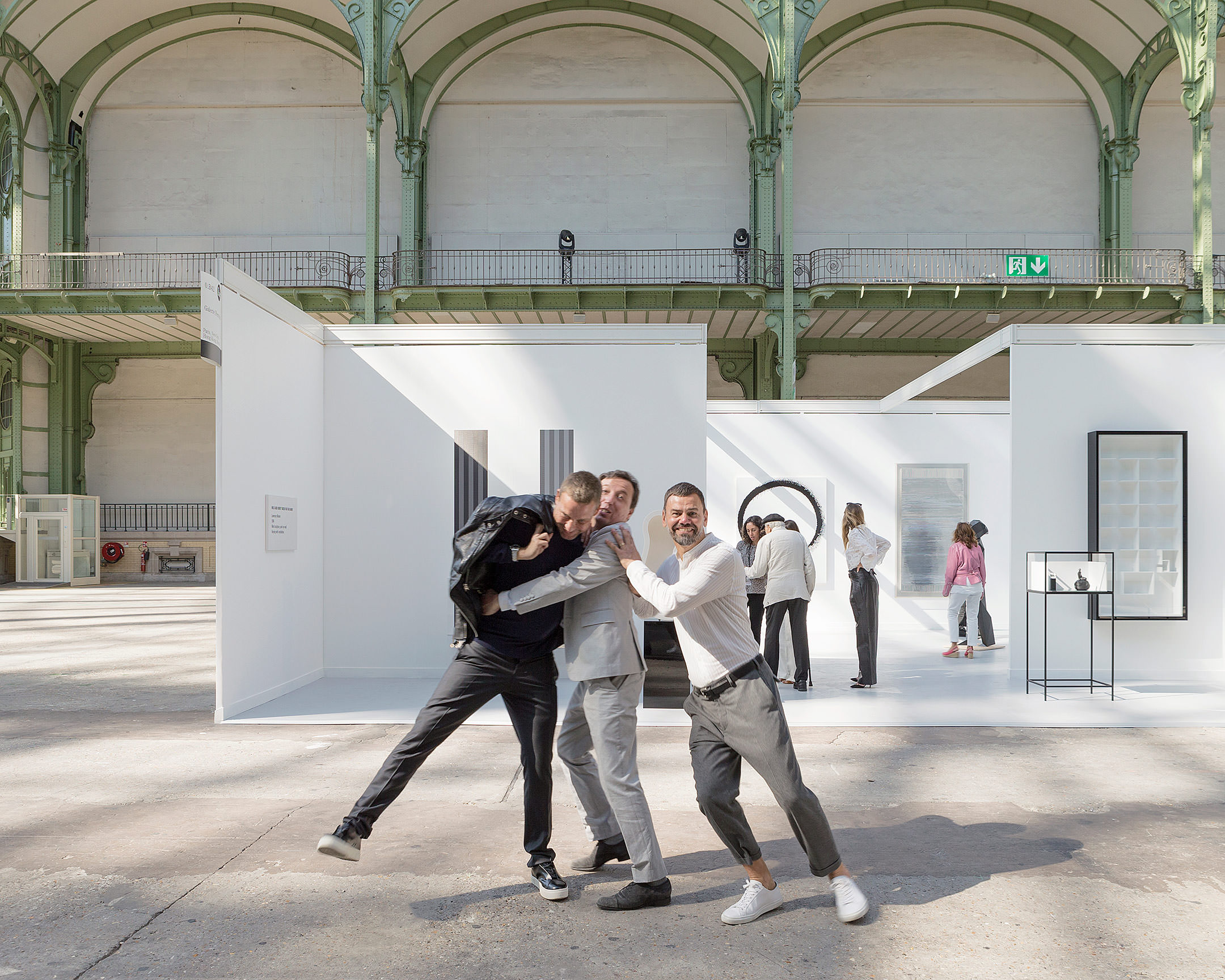"Portrait of Elmgreen & Dragset and Emmanuel Perrotin in front of the one-day exhibition Elmgreen & Dragset présentent la Galerie Perrotin au Grand Palais in Paris on Saturday, September 24th 2016. Photo Claire Dorn, courtesy Galerie Perrotin   Another of the duo's specialities is playing with the codes of the art world. At the Venice Biennale in 2009, their offering was a hyper-real reproduction of a fictive collector's apartment (complete with art works) and who we discover drowned in his swimming pool. Today's intervention is a continuation of their exhibition at the Ullens Center for Contemporary Art (UCCA) in Beijing where they showed a fake contemporary art fair presenting 88 of their own works. ""What's funniest is imagining the stand staying here until the opening of the FIAC with the rest of the fair being erected around it. As if the Perrotin Gallery stand is the centre of the world..."" The duo has never been short of humour and irony, even their gallery isn't spared.     By Thibaut Wychowanok"