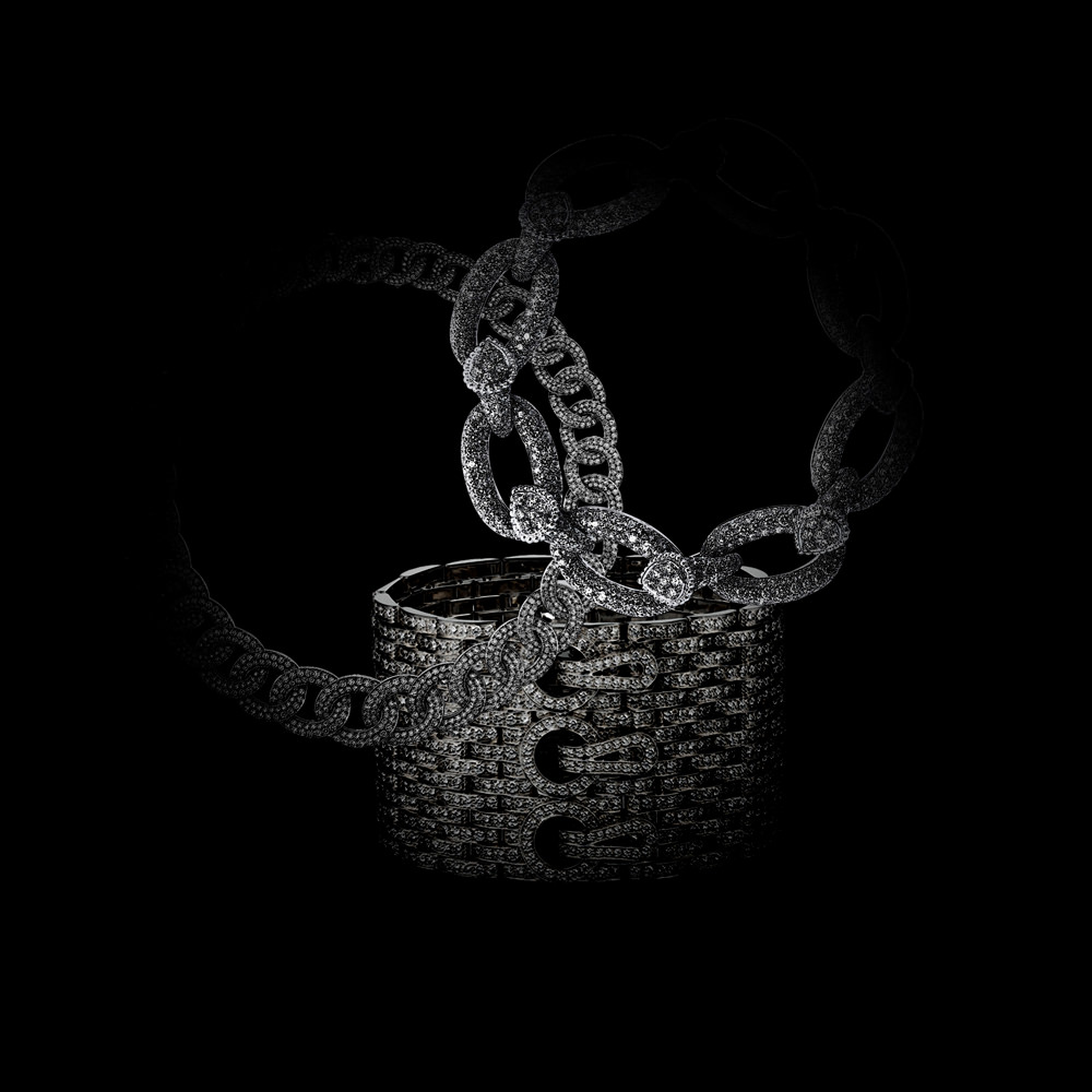 """""""Olympia"""" necklace,white gold and diamonds, VAN CLEEF & ARPELS. """"Maillon Serpent Bohème"""" bracelet,white gold and diamonds, BOUCHERON. """"Maillon Panthère"""" cuffs,grey gold and diamonds, CARTIER.  Selection by Rebecca Bleynie."""