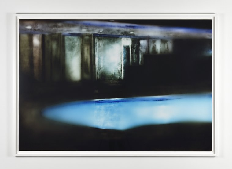 MATT SAUNDERS, Mulholland, 2016. C-print Kodak Endura Premiere. Image: 46 13/16 x 68 7/8 in. (119 x 175 cm). Courtesy the artist and Marian Goodman Gallery, Paris   To create his images, Matt Saunders uses a technique that dips into alchemy. After choosing an image (from a film, or a postcard etc.) and having reproduced it in paint on a large scale canvas, he puts the result onto photo paper and exposes it to light. The light passes through the canvas where the paint doesn't stop it and makes the photographic paper react. The result is a photograph that looks like a negative of the painting.    After this dizzying mise en abyme, his works appear to be in perpetual movement with his more or less mastered effects of blurring and lines. Over the last few years they've become increasingly abstract, intriguing and thus absorbing ever more of the gaze. The artist's technique has also evolved. Today he uses a projector that allows him to enlarge different images at the same time onto the same canvas.     Flux, multiplication and the saturation of images are all at work in the paintings and video installation presented by the artist at the Marian Goodman Gallery in Paris until June 4th. For the occasion, Matt Saunders shared with us a few keys to understanding his work.
