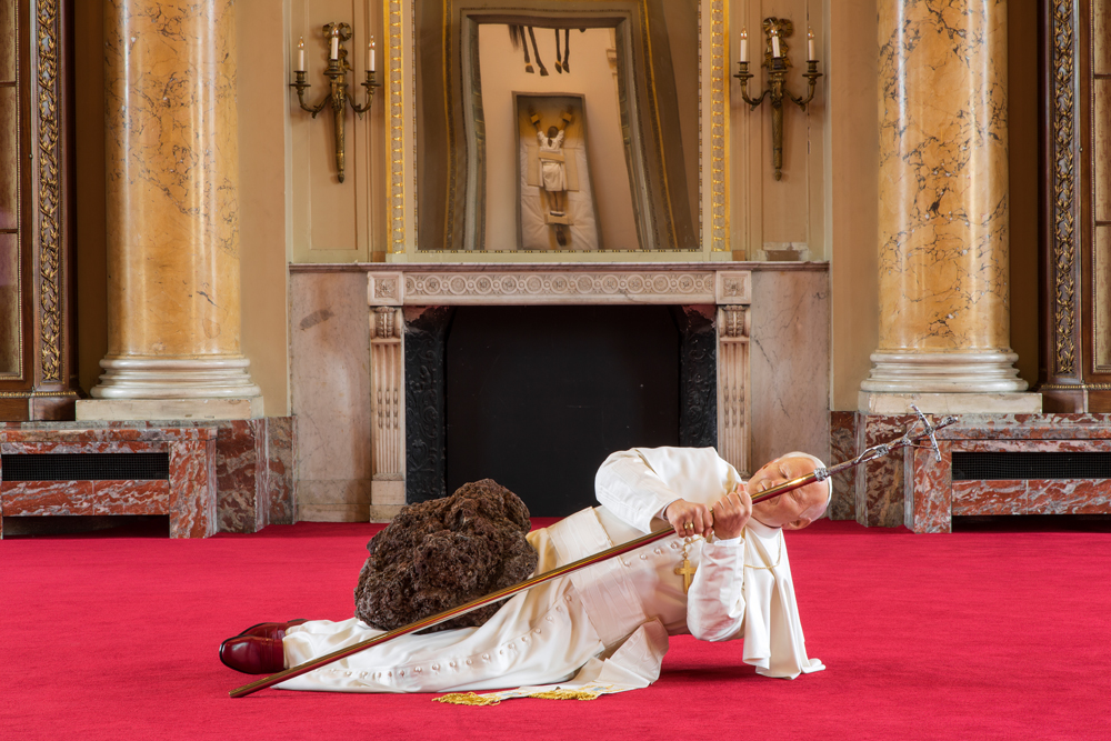 "Foreground :  Maurizio Cattelan, La Nona Ora, 1999 Polyester resin, silicon gum, pigment, natural hair, fabric, clothes, accessories, stone, carpet Background :  Maurizio Cattelan, Sans titre, 2007  Silicon gum, natural hair, wood box, wrapping fabric, screws Maurizio Cattelan, Novecento, 1997  Stuffed horse, leather saddlery, rope, pulley Photo : Zeno Zotti  View from Maurizio Cattelan exhibition, Not Afraid of Love at Monnaie de Paris, from october 21rst 2016 until January 8th 2017     Numéro : What criteria did you use when selecting the works to be shown at the Monnaie de Paris? Maurizio Cattelan : Like many events in a career, it started out as a completely different project. But if life is not always linear, neither are exhibitions. At the very beginning, a solo show was not part of my plan, but then I realized I could stay behind the scenes and direct a new editing of some of my works. It's an interesting experiment. It's like listening to a group of individual voices that slowly intone, and in the end become a real chorus.     "" I tend to flee tragedies – usually via the emergency exit."" Maurizio Cattelan"