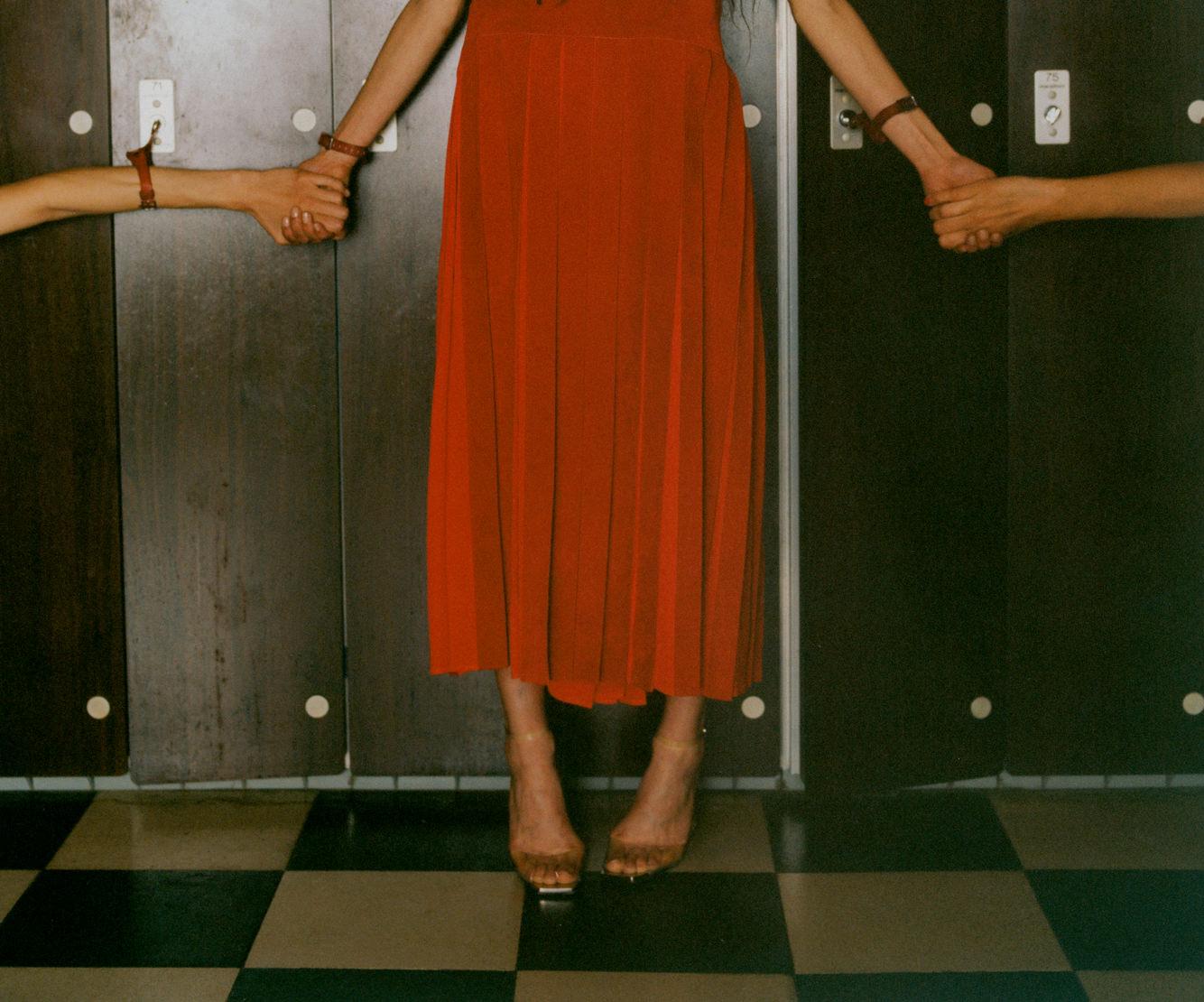 Skirt, HERMÈS. Sandals, LOEWE.