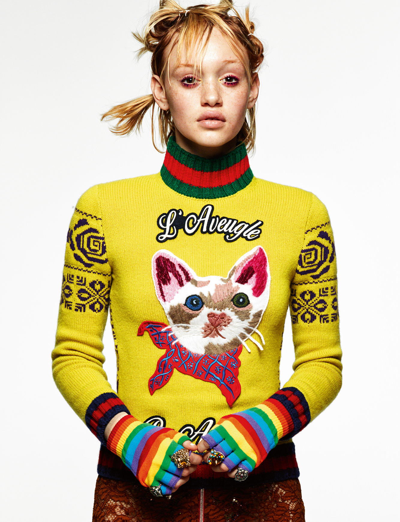 Jumper, skirt and rings, GUCCI. Mittens, AMAZON.COM.