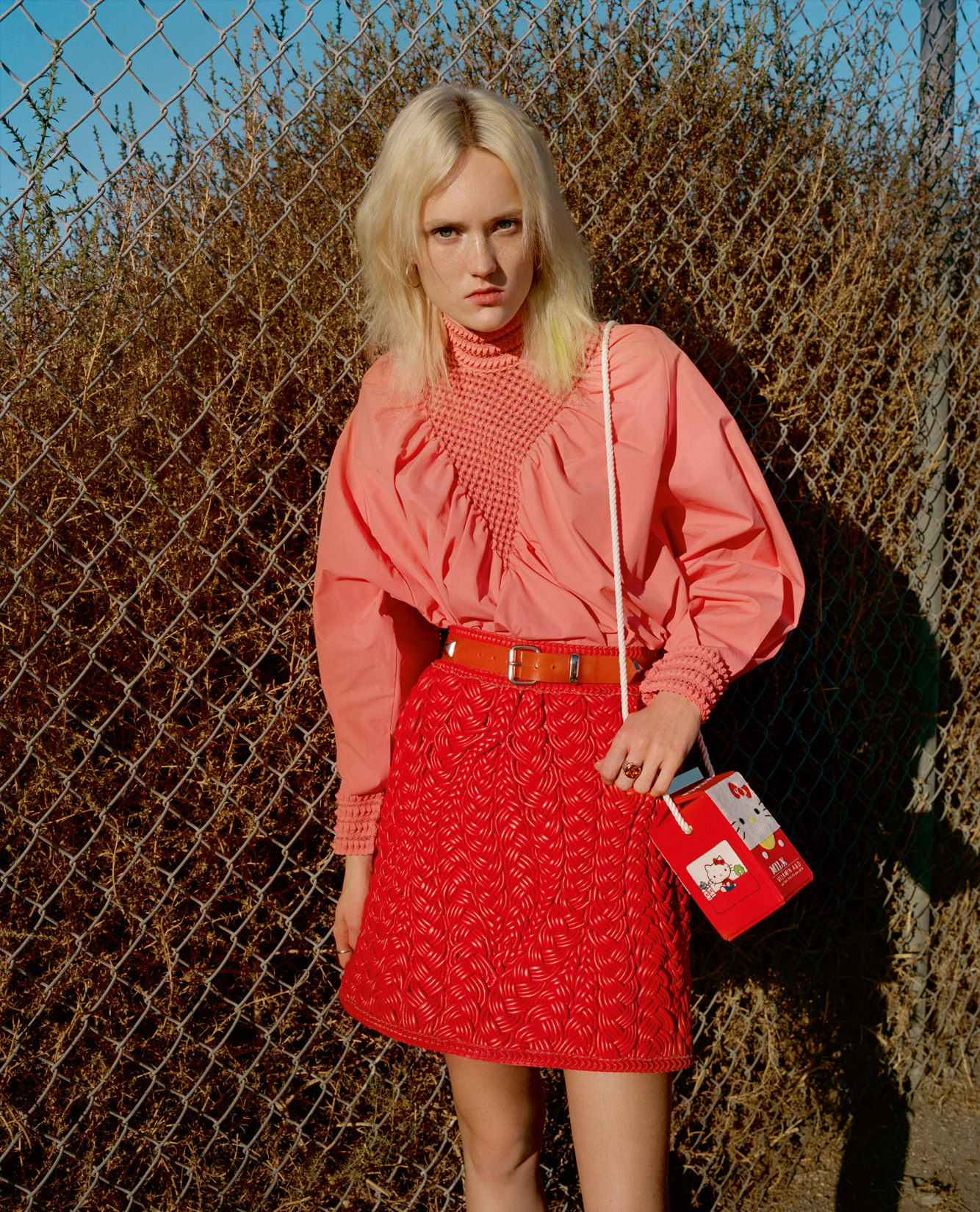 Top and skirt, FENDI. Bag, OLYMPIA LE-TAN. Belt, FUNKYTOWN. Earrings, CARTIER. Rings, SEARCH&DESTROY.