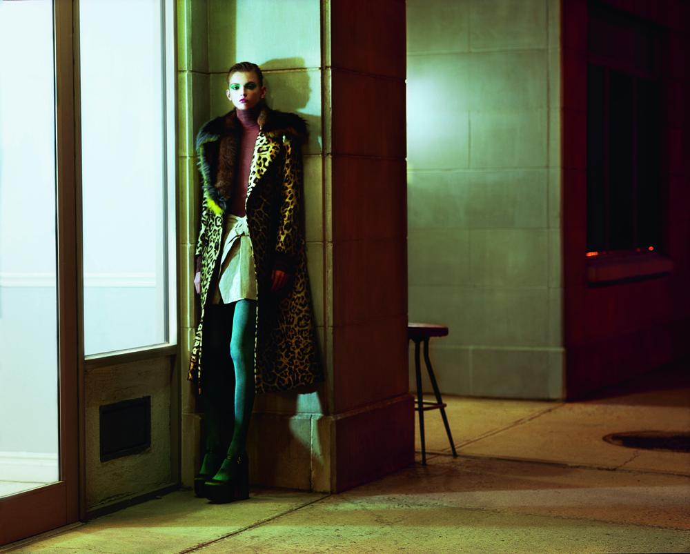 Leopard printed coat with fox collar, ERMANNO SCERVINO. Body, NINA RICCI. Vinyl skirt, ISABEL MARANT. Tights, FALKE. Shoes, ROCHAS.