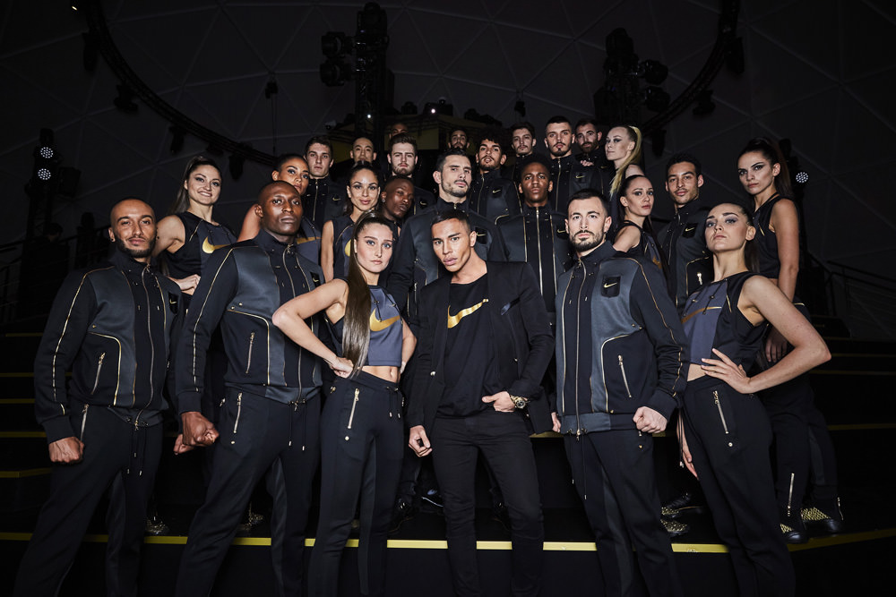 Olivier Rousteing surrounded by dancers. The collection was presented with a 3D show made by Super Bienwith a football theme while the athletic performances were choreographed by I could never be a dancerto music produced byManare.