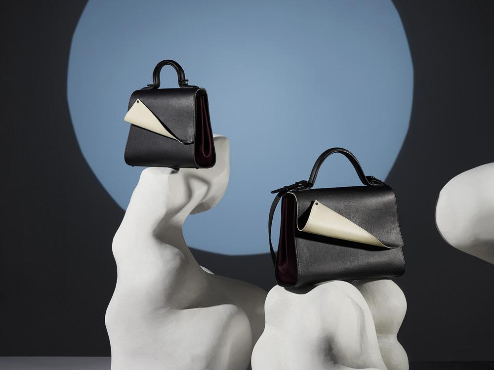"""Vous apportez à la maison un style contemporain. D'où vous vient cette idée de convertir le sac en un objet ludique?  Je ne dessine pas de sacs trendy. J'aime concevoir des objets élégants, mais l'élégance peut être très ludique. J'adore jouer avec les couleurs, et je m'intéresse beaucoup au portd'un sac. J'ai ainsi imaginé la """"Pochette Gant"""" [ou """"Glove Clutch"""", gros succès de la maison], dans laquelle on glissesa main. J'aime travailler des matériaux inhabituels et je m'inspire beaucoup du design de meubles, mais aussi de l'art moderne: Jean Arp, Malevitch… Sur la collection de l'été 2017, que je suis en train de terminer, je me suis inspirée des illusions optiques du photographe Georges Rousse. Et pour l'automne-hiver 2016, j'ai appliqué au travail du cuir des techniques d'origami. J'ai collaboré, pour le lookbook, avec une set designer de mon âge, qui a réalisé des sculptures d'après les œuvres de Jean Arp. Dans les images, les ongles du mannequin sont d'une longueur inquiétante, en hommage à une photo de Man Ray que j'aime beaucoup. Nous sommes une marque à héritage familial… avec un côté déjanté bizarre.  www.perrinparis.com"""
