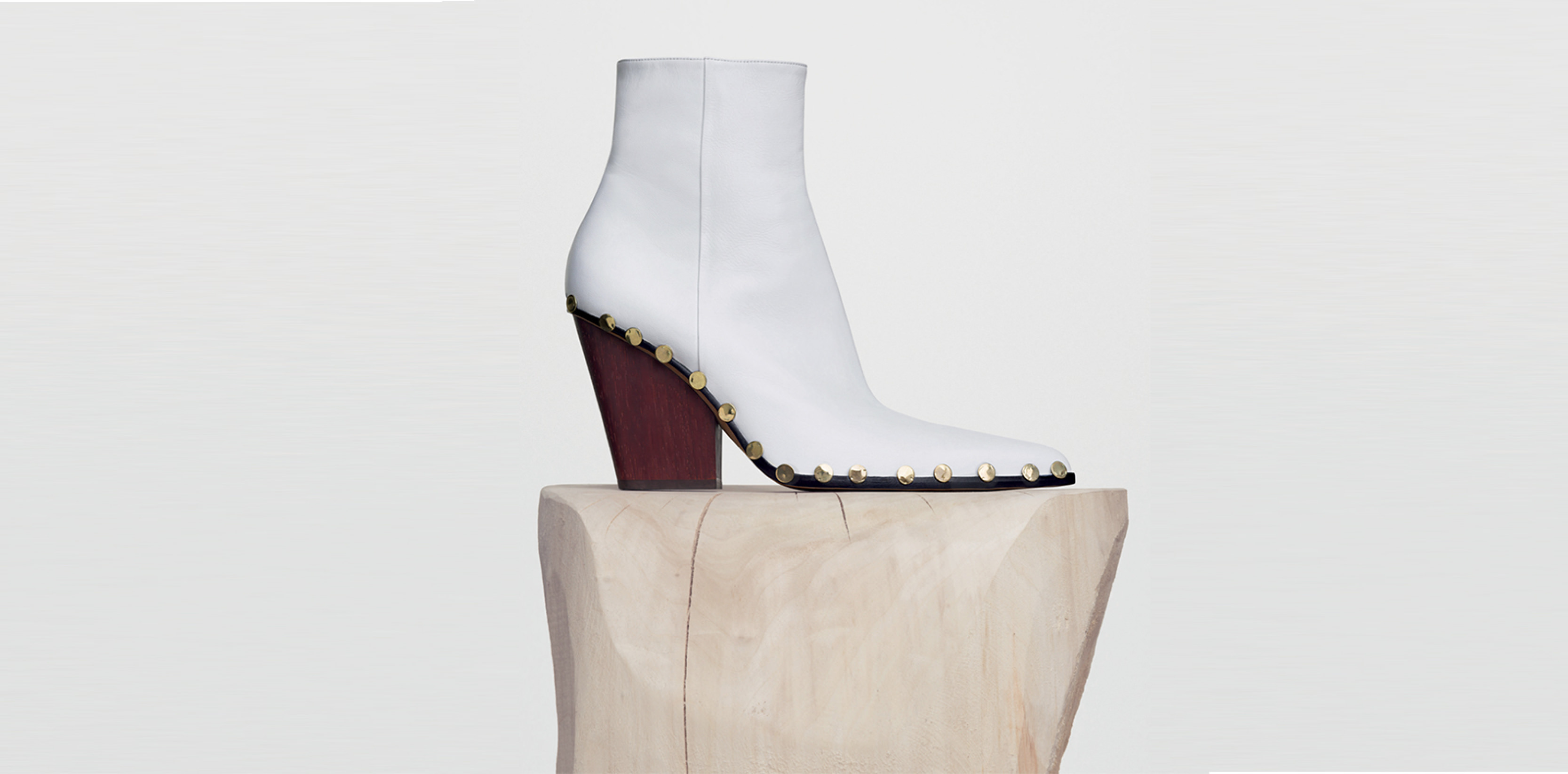 """""""Rodeo"""" boot, studded details, wood heel and white lamb leather, CÉLINE.   Selection by Rebecca Bleynie"""