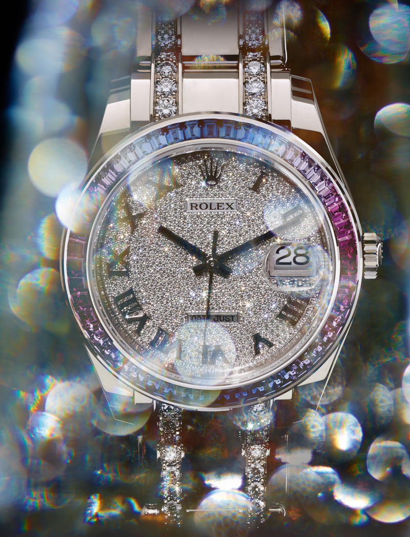 "Montre ""Oyster Perpetual Datejust Pearlmaster 39"" en or gris, saphirs et diamants, ROLEX.  Numérique : Sun Lee. Retouche : The Shoemakers Elves. Production : LGA Management."