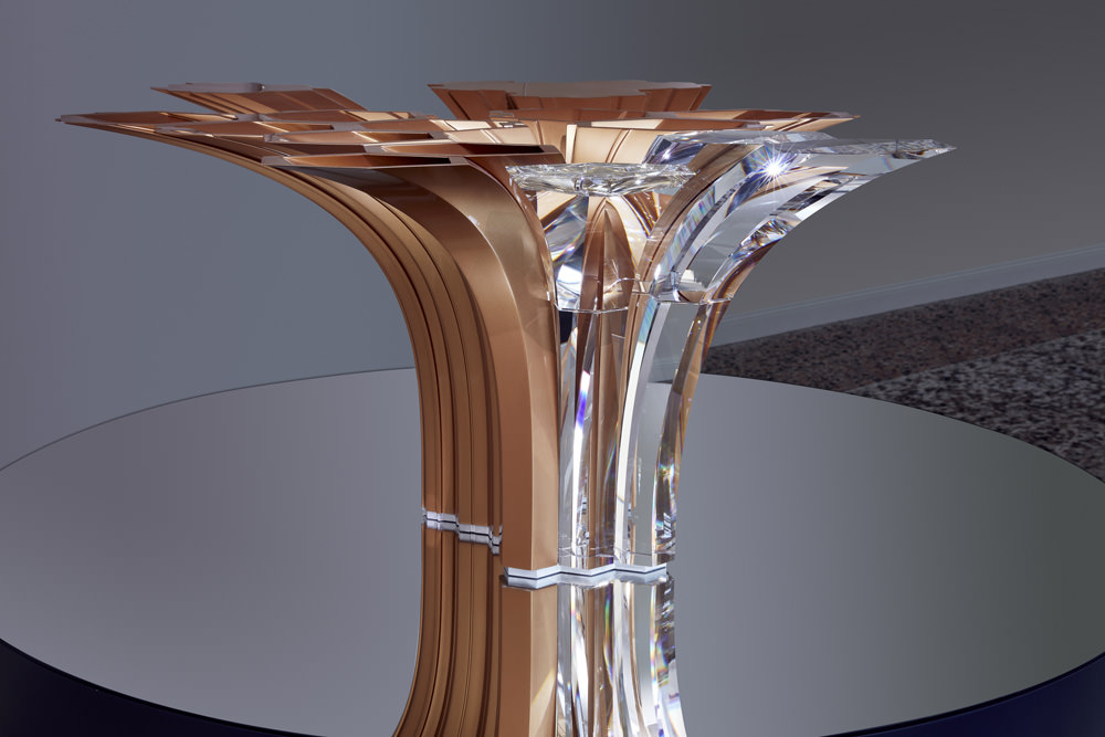 CristabyZaha Hadid. Cristal and metal table centerpiece.   Created in collaboration with some of the greatest international designers along with promising young talents, the first collection by Atelier Swarovski Home expores different techniques of fabrication of objects. Combining cristal, marble, metal, and other precious materials, deZaha Hadid,Ron Arad, Aldo Bakker ou Kim Thomé's exceptional objects open a new chapter for home where work of art meets daily life.