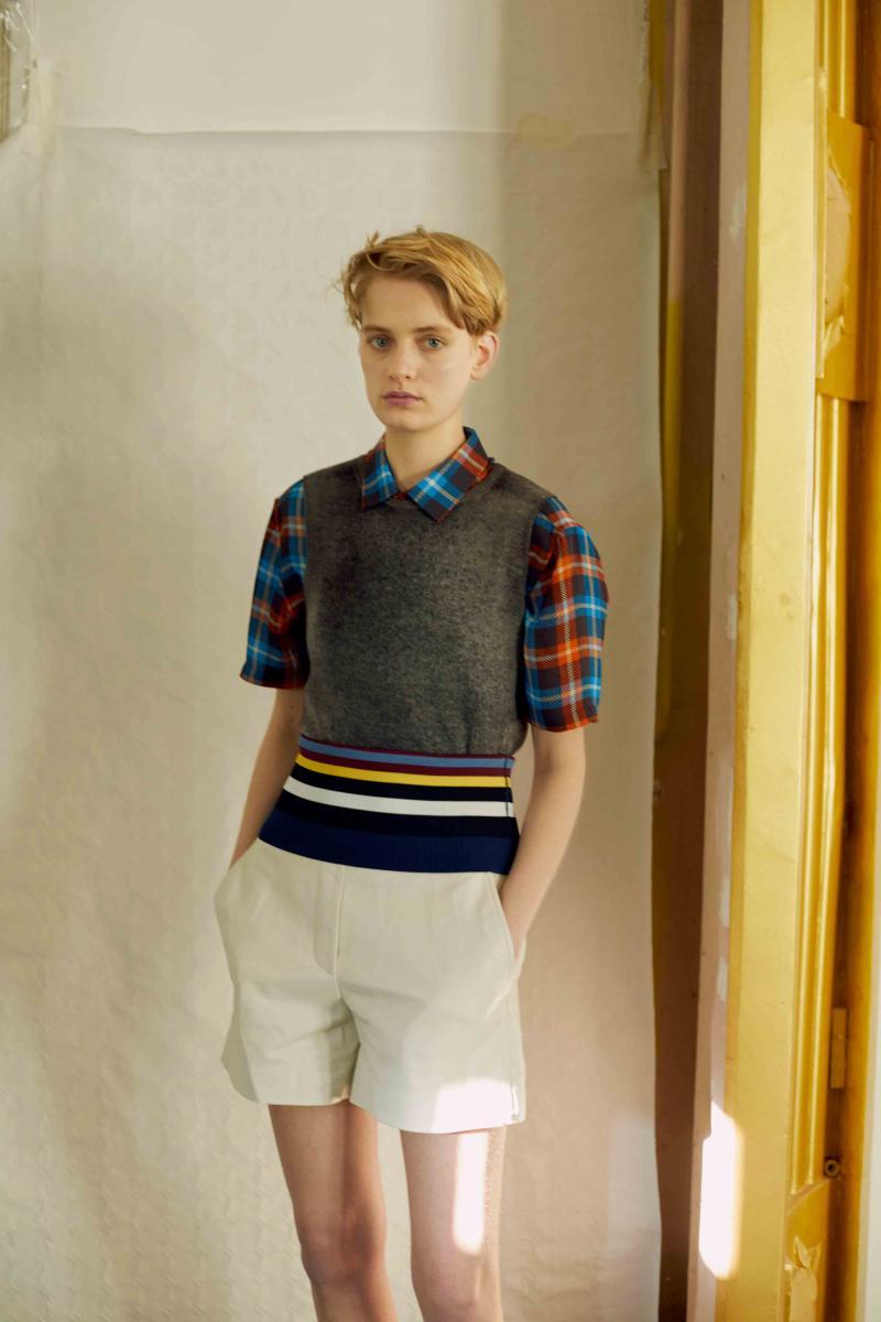 Sleeveless sweater, AVANT TOI. Checked shirt, JOSEPH. Leather short, SPORTMAX.