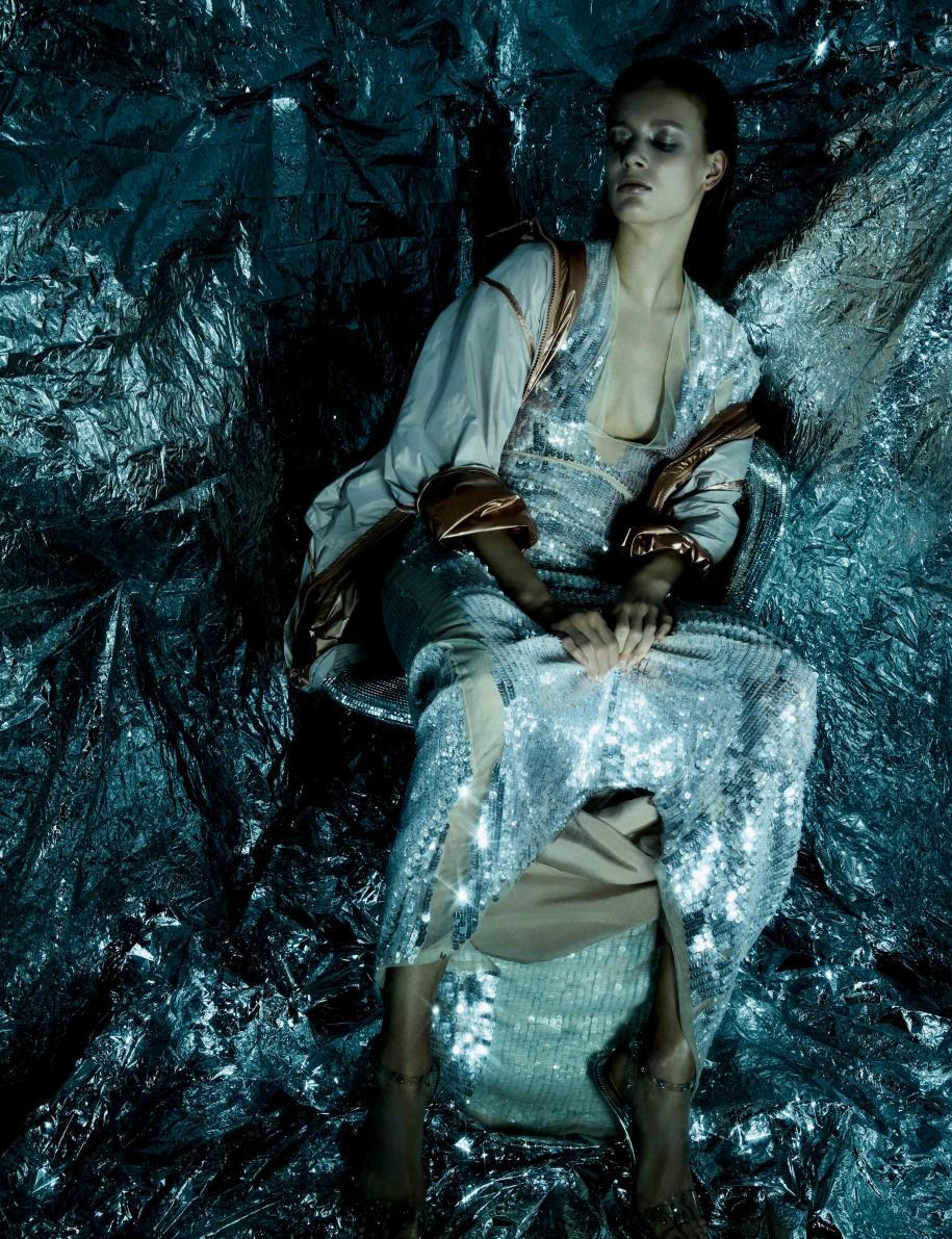 Trench coat, Y-3. Dress, BLUMARINE. Sandals, GIUSEPPE ZANOTTI.