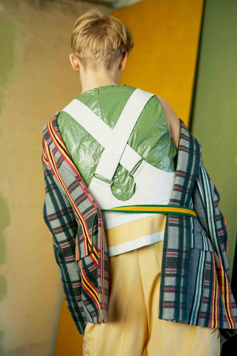 Veste en laine écossaise, bustier à bretelles croisées en veau et combinaison en crêpe de soie, HERMÈS. Débardeur en vinyle, COS.
