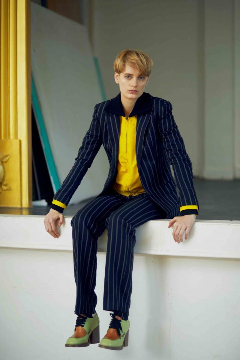 Striped woolen suit, TAGLIATORE. Zip jacket, GOLDEN GOOSE DELUXE BRAND. Shoes, MARNI.