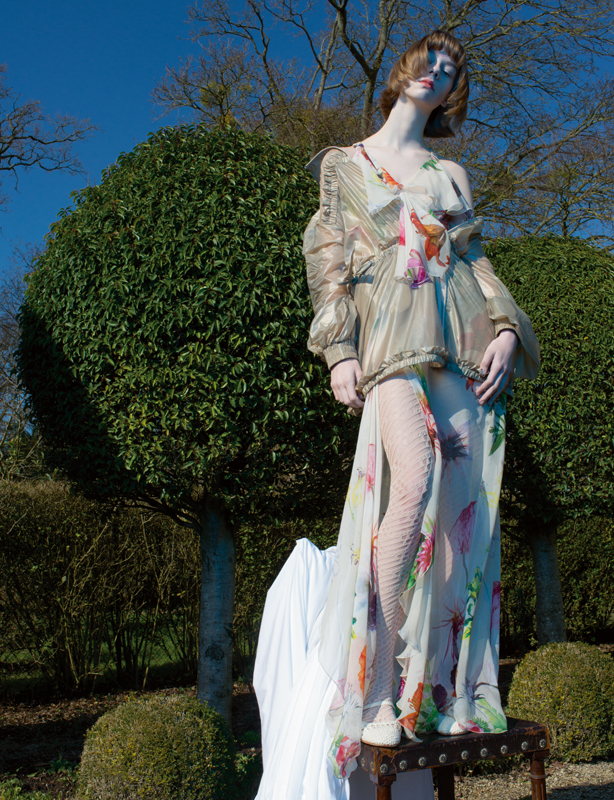 Dress, BLUMARINE. Nylon vest, FENTY PUMA BY RIHANNA. Tights, CHANEL. Shoes, REPETTO.