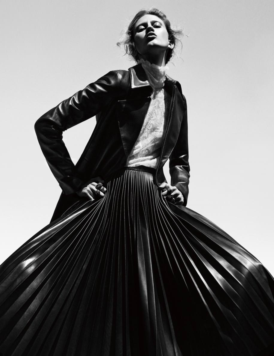 Trench, REDEMPTION. Blouse, ALTUZARRA. Skirt, ALEXANDER WANG. Rings, UGO CACCIATORI, WE WHO PREY and SABINE G.
