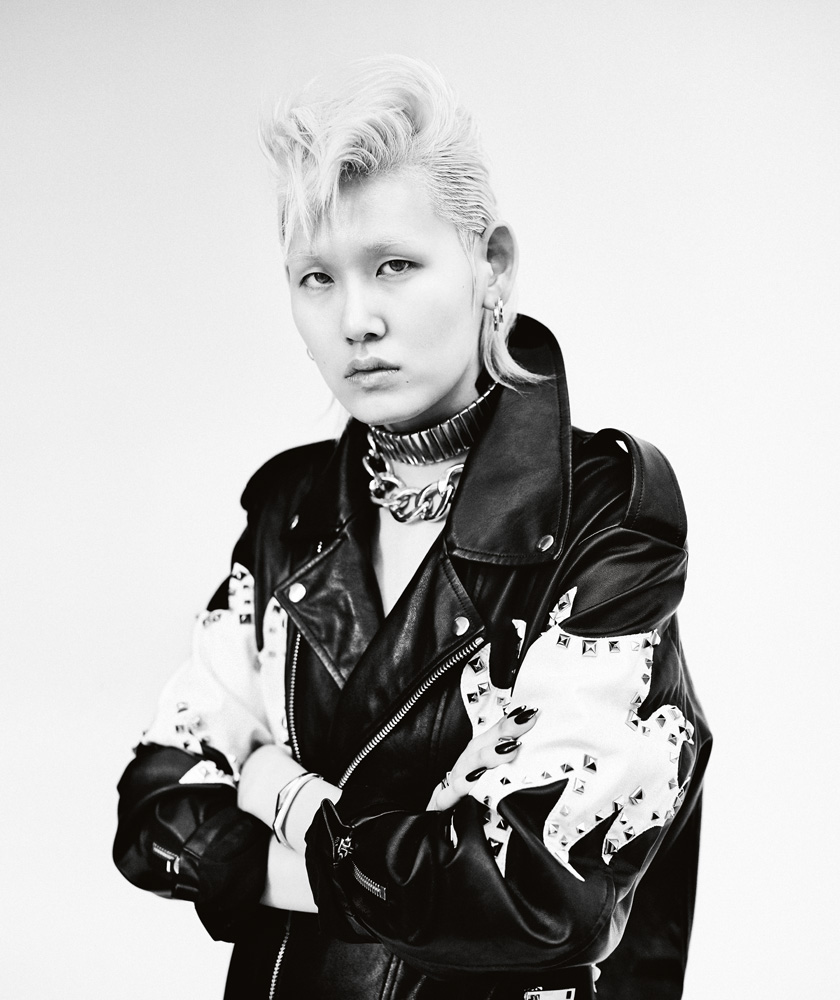 Leather jacket, REDEMPTION. Earrings and bracelets in gold and diamonds, REPOSSI. Vintage necklaces.