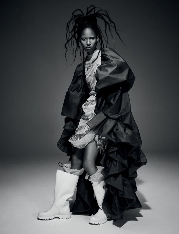 Printed Nylon sweater and skirt, and tulle skirt embroidered with pearls, KENZO. Bubble latex coat, Y/PROJECT. Boots, PRADA.