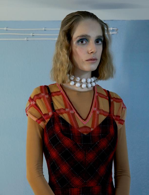 Sleeveless tweed dress and checkered Nylon T-shirt, MIU MIU. Necklace, BALENCIAGA. Body, REPETTO.