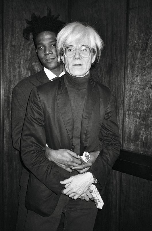 Jean Michel and Andy at The Rockefeller Center, September 19, 1985 Copyright: © The Andy Warhol Foundation for the Visual Arts, Inc.