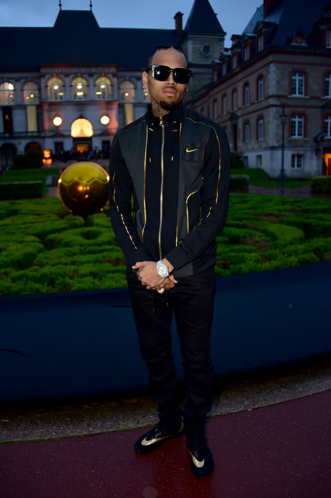 Chris Brown dressed in NikeLab x Olivier Rousteing at the launch party.   This collaboration was also a chance for Olivier Rousteing to show some love to the footballers who can't get enough of him. To celebrate the Euro 2016 which starts in Paris on June 10th, the designer is proposing a complete football kits for men and women in black and gold. In an audacious fusion of a traditional runway show, a dance number and video animation on the walls of a vast dome installed especially for the occasion, the presentation of the collection in Paris saw dancers/footballers leaping in the air to kick the image of a golden ball. A football fan himself, a sparkly-eyed Olivier Rousteing, couldn't stop grinning as he took a modest bow at the end. Without attempting any acrobatics…     NikeLab x Olivier Rousteing, on sale in the NikeLab boutiques and on nike.com.     By Delphine Roche