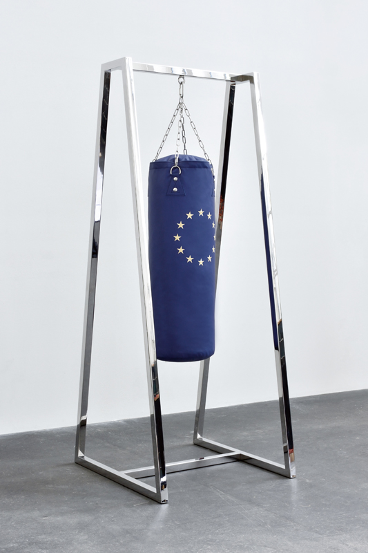 """Anger Management"" (2018). Punching bag, leather and metal, 221.5 x 80 x 100 cm. Work exhibited at the Whitechapel Gallery."