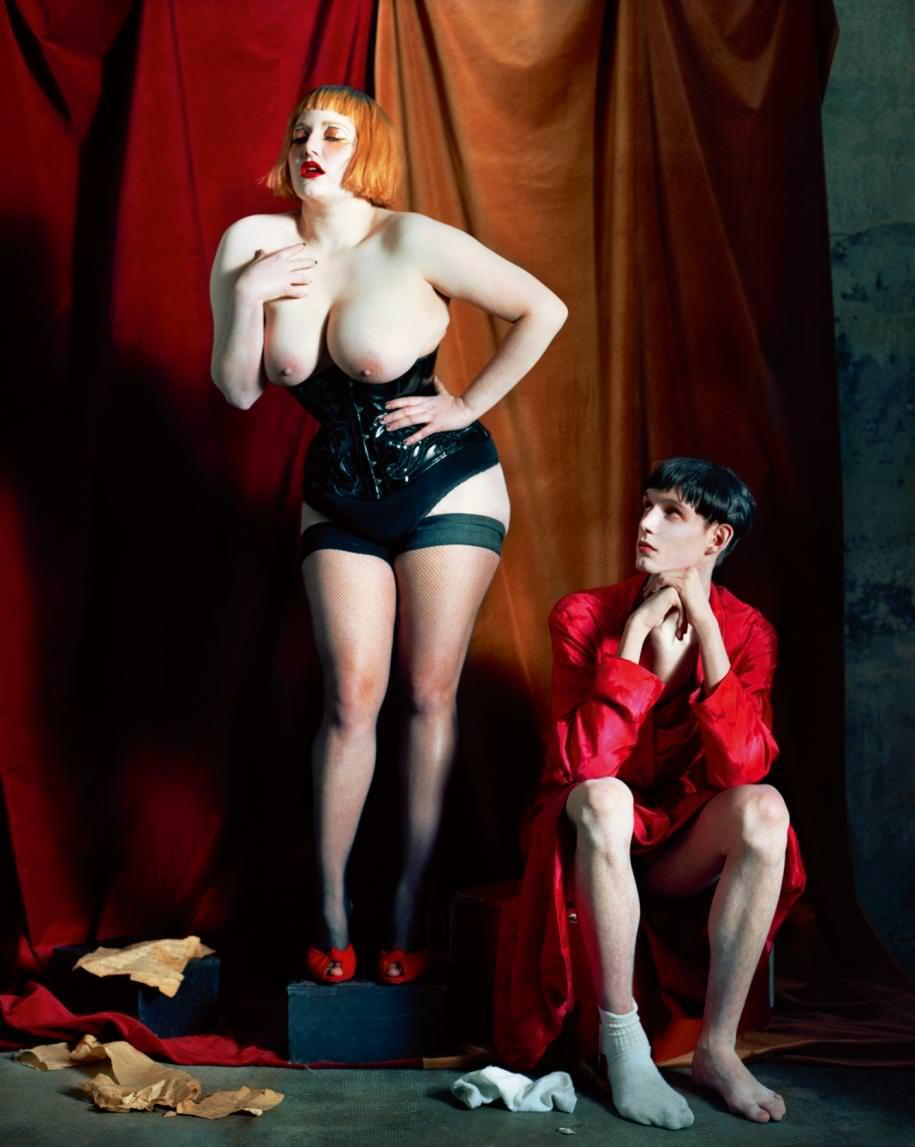 Her: corset, ATELIER SYLPHE. Nickers, INTIMISSIMI. Mules, GIUSEPPE ZANOTTI DESIGN. Downs, FALKE. Him: dress, LA PERLA.