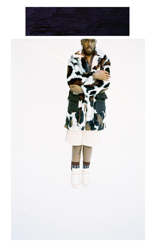 Coat KENZO, Shirt BOTTEGA VENETA, shortLAURENCE AIRLINES, shoes PIERRE HARDY, socksBOTTEGA VENETA.