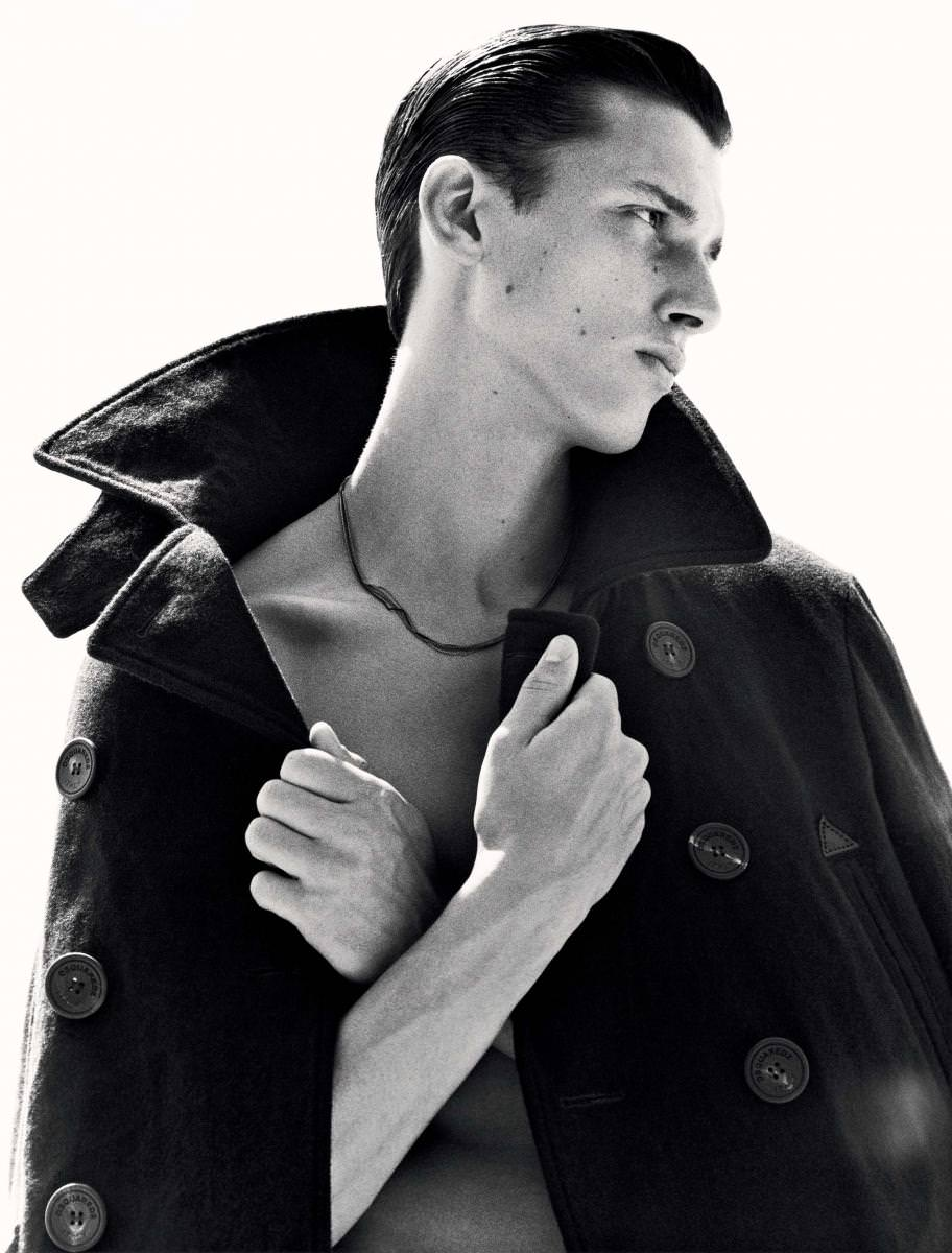 Raincoat, DSQUARED2. Necklace, PAUL SMITH       Realisation : Jean Michel Clerc assisted by Magali Martin. Model : Luca Stascheit from Success Models. Stuntman : Sébastien Jolly. Make-up : Min Kim chez Airport Agency. Haircut : Terry Saxon chez Jed Root. Silver gelatin black&white prints made by hand by Peter Guest from The Image London. Touch-up : Granon Digital. Production : Artsphère. Many thanks to Alexis Demeulemeester and Amélie Binot from La Mer de Sable.   Check out the whole series in Numéro Homme Force fall-winter 2015, available now in newsstands and on iPad.   → Subscribe to the print edition of Numéro → Subscribe to the Numéro iPad app