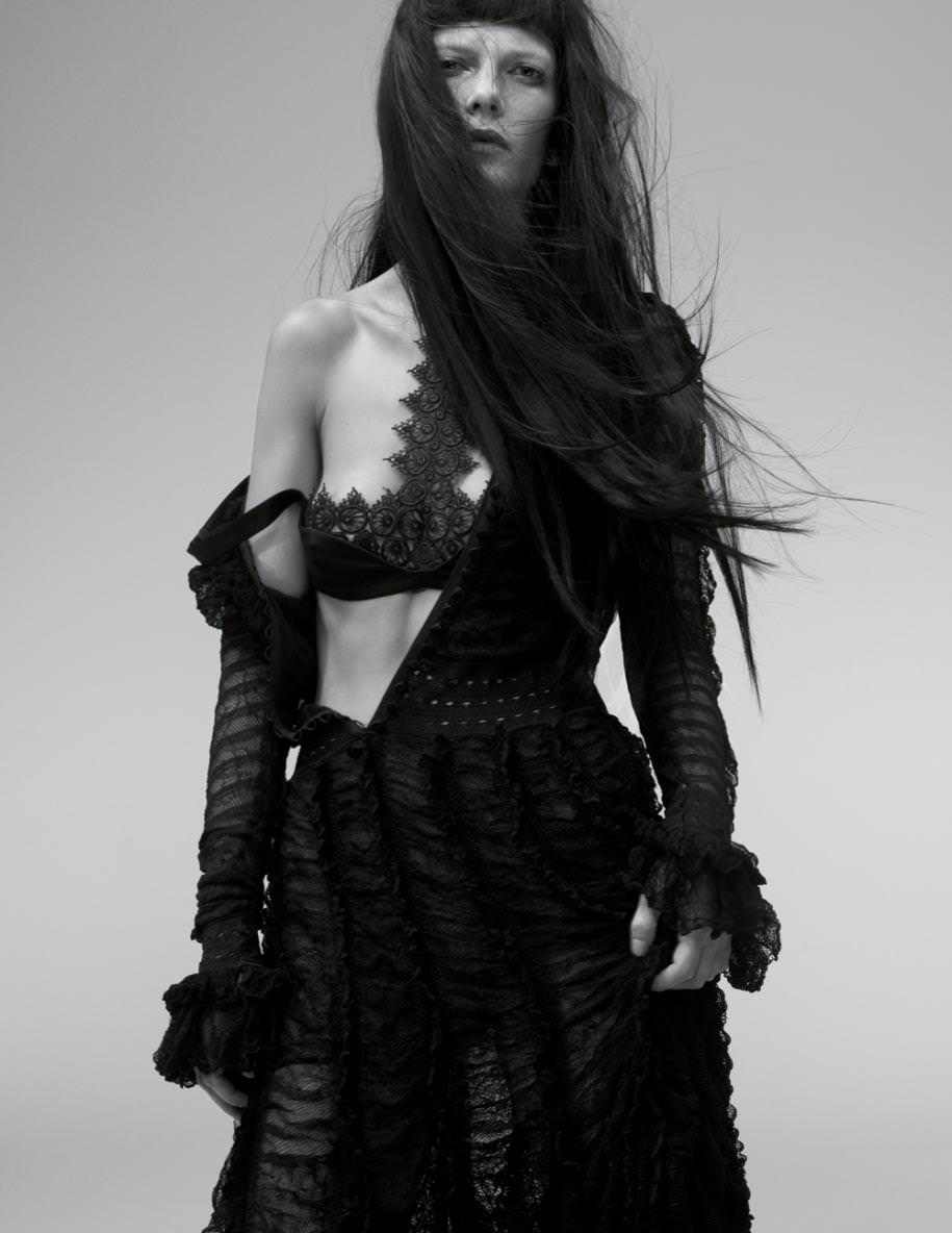 Dress and lace bra, ALEXANDER MCQUEEN. ​