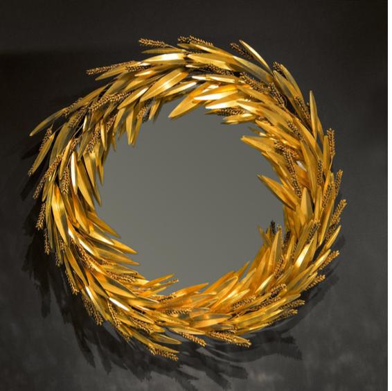 """ROBERT GOOSSENS (Français, 1927 - 2016) Miroir """"Épis de Blé"""" / """"Crown of Wheat"""" mirror Verre bombé orné de bronze doré imitant le blé , France, ca 1970 Prix sur demande Signé et daté D 70 cm"""
