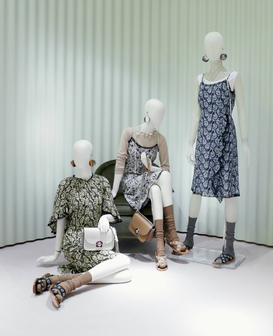 """The Italian housePrada imagined a floral and romantic capsule collection for the spring-summer 2016 season in which dresses, vests, skirts and crepe trousers adorn themselves with floral designs and delicate lace. Miucci Prada, loyal to her rebellious spirit, accompanies her creations with over the knee socks and flat sandals in a chic and grungyenergy.  To discover in Prada stores.  Check out thePrada fall-winter2016-2017 runway show. Check out Prada's """"Cahier"""" bag.  By Léa Zetlaoui"""