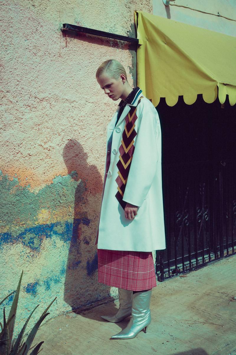Coat, polo shirt, and skirt, MIU MIU. Boots, MARC JACOBS.