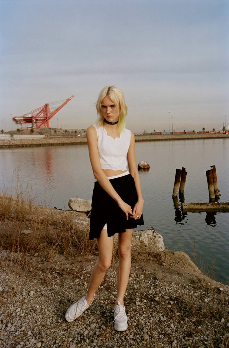 Tanks top and skirt, DIOR. Crew-neck and rings, SEARCH&DESTROY. Sneakers, GANNI.