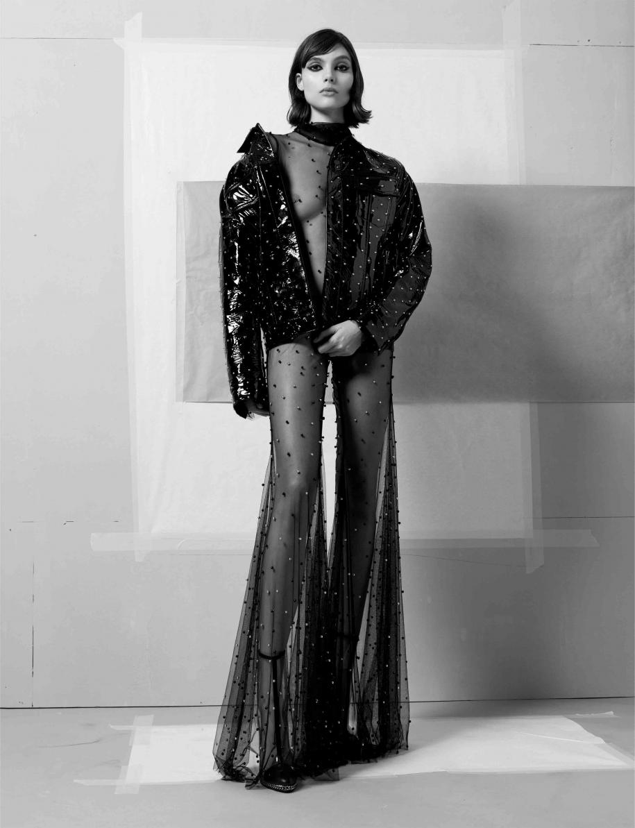 Hobnailed patent leather jacket and ankle boots, BALMAIN. Tulle dress embroidered with pearls, HALPERN.