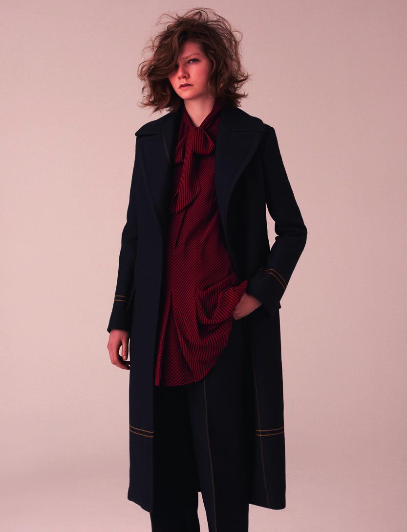 Wool coat and pants, JIL SANDER. Silk dress, Saint Laurent par HEDI SLIMANE.