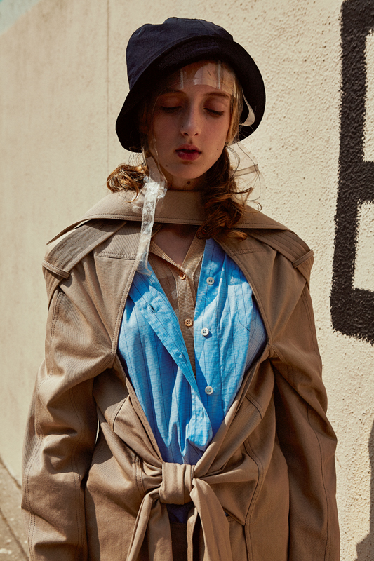 Cotton trench coat, LOEWE. Cotton poplin shirt, MIU MIU. Striped jersey dress and floral viscose trousers, ACNE STUDIOS.