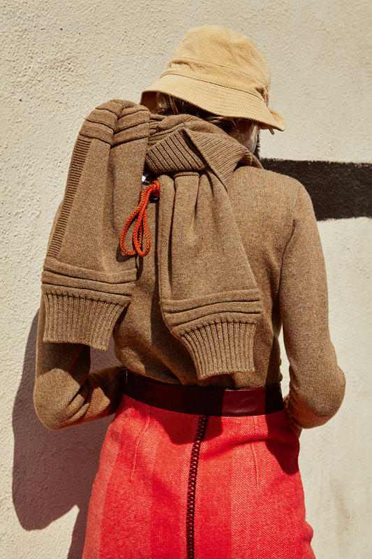 Cashmere sweater dress, wool and cashmere skirt, HERMÈS. Wool trousers, DRIES VAN NOTEN. Bob, LACOSTE.