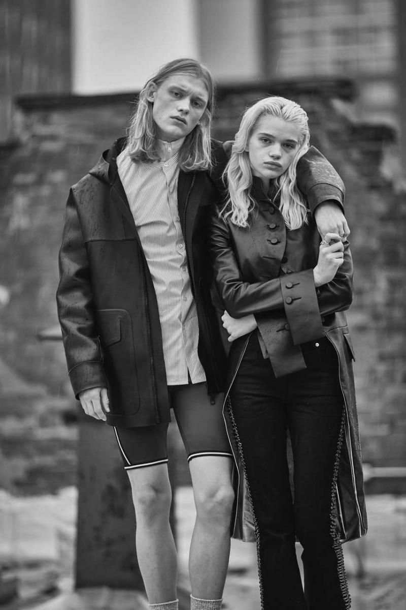 Her: leather redingote and gabardine trousers, LOUIS VUITTON. Him: leather jacket, poplin cotton shirt, neoprene cycling short and turtleneck sweater, LOUIS VUITTON.