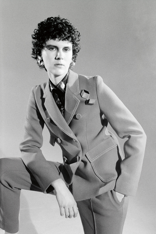 Wool tailor-trousers, BOTTEGA VENETA.Lurex blouse, ISABEL MARANT. Earrings, ALIGHIERI.