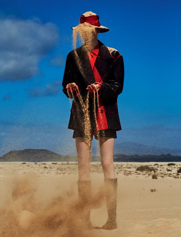 Moleskin coat, cotton short, silken shirt and boots, PRADA. Hat, WORTH & WORTH.