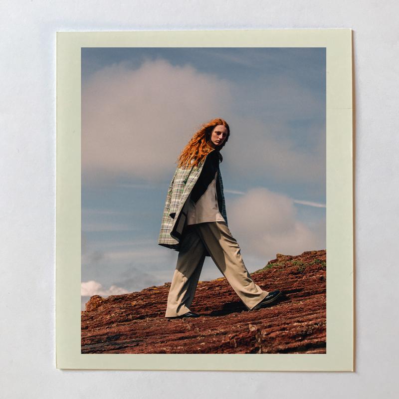 Printed cotton canvas coat, BURBERRY. Leather shirt and woolen trousers, CÉLINE. Shoes, DR. MARTENS.