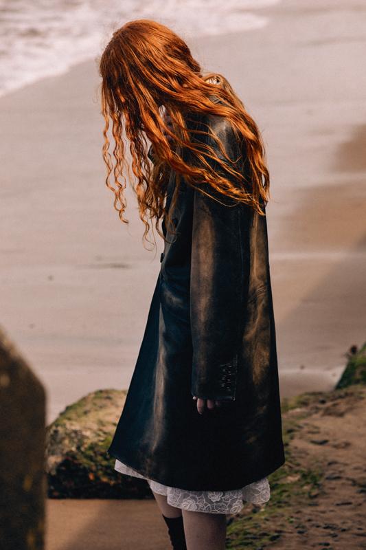 Leather coat and lace dress, MIU MIU.
