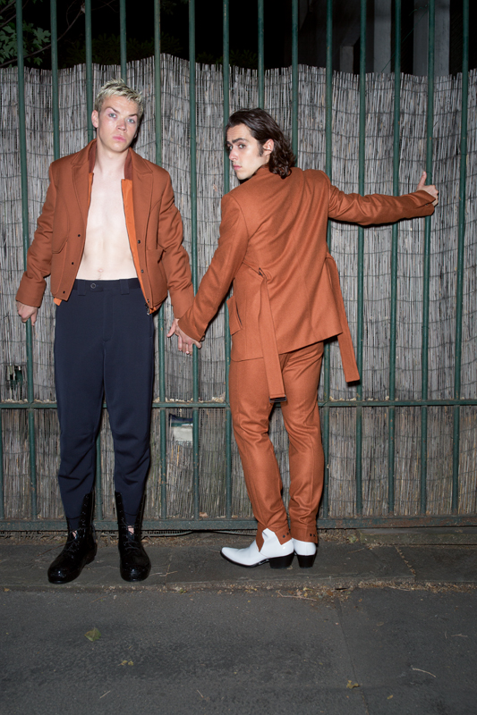 Left: wool and mohair coat, Ermenegildo Zegna Couture. Cotton trouser, Fendi. Boots, Raf Simons. Right: belt jacket and wool trouser, Ermenegildo Zegna Couture. Boots, Calvin Klein 205W39NYC.