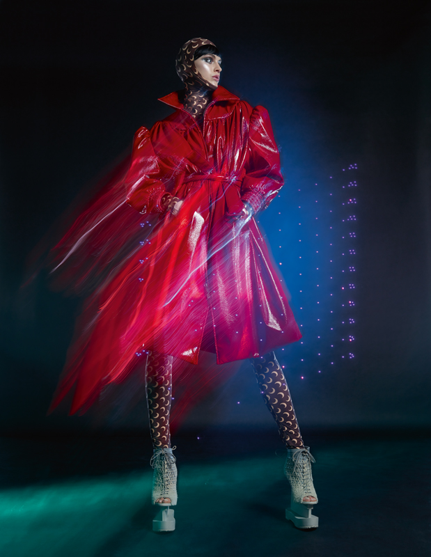 Leather coat, MIU MIU. Slip and hood, MARINE SERRE. Shoes, IRIS VAN HERPEN COUTURE.
