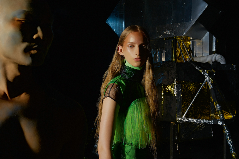 Turtleneck and strapless fringed Nylon gabardine, and short black organza top, PRADA.